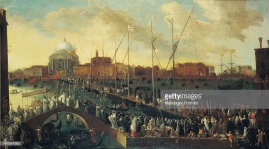 """Procession of the Feast of the Redeemer (La processione del Redentore), by Joseph Heintz the Younger, 17th Century, oil on canvas, 115 x 205 cm Italy, Veneto, Venice, Museo Correr. Whole artwork view. Representation of the Feast of the Redemeer, tradizional Venice feast born along the 16th Century and celebrating the reconstruction of the Church of Redeemer, ordered by the senate as a sign of gratitude for the end of the plague; the church stands out on the background with its dome; in the middle, the bridge made of floating platforms which link the Isle of Giudecca to Venice; on San Marco lagoon, are coming gondolas and boats in order to take part at the celebration. (Photo by Reale Fotografia Giacomelli/Electa/Mondadori Portfolio via Getty Images)"""